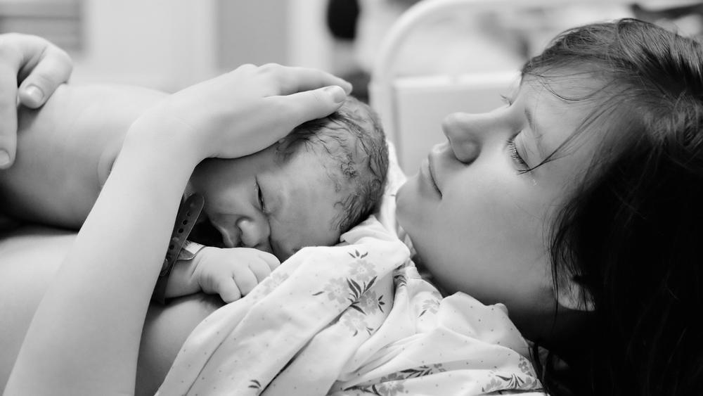 NICU mom holding NICU baby