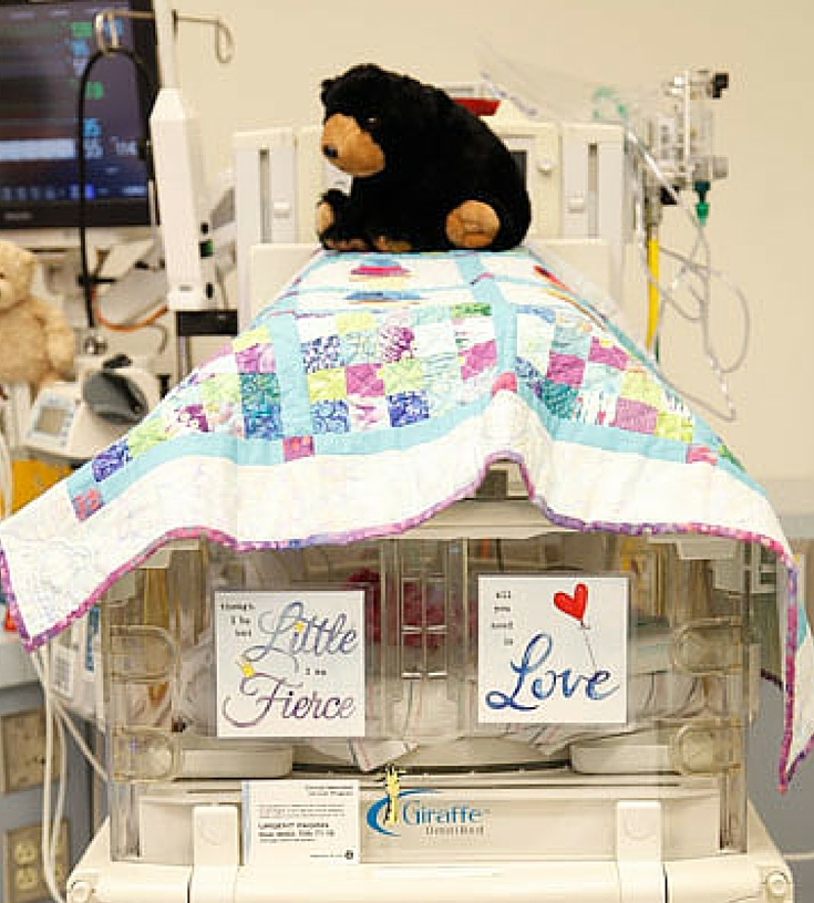 NICU Art Decorating a preemie isolette