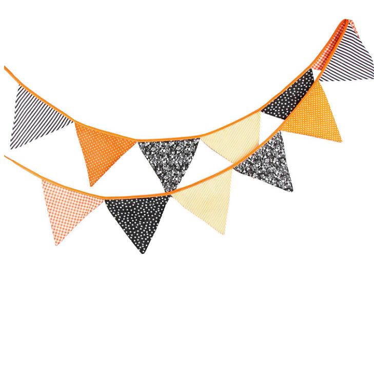 use halloween-themed bunting to drape on the crib for NICU halloween decor