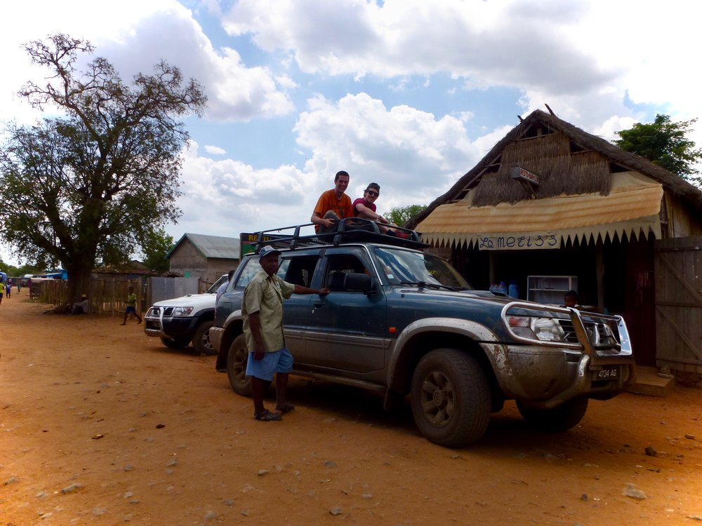 Our car troubles didn't stop there. On the way back, our jeep broke down and we had to abandon it, some riding on the roof of another car to get back to the village.