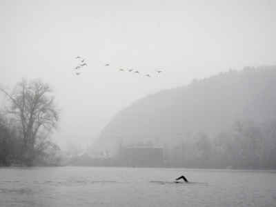 Swain strokes toward Little Falls, NY in a blizzard, during his Mohawk River Swim.