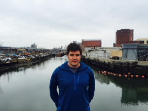 Christopher Swain in front of the Gowanus Canal, just downstream of the Third Street Bridge in Brooklyn, NY