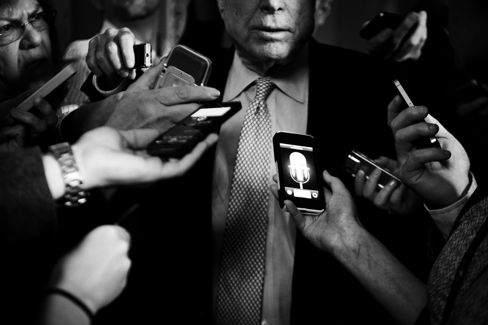Reporters swarm around Senator John McCain of Arizona pressing for questions on the negotiations between the senate leaders.