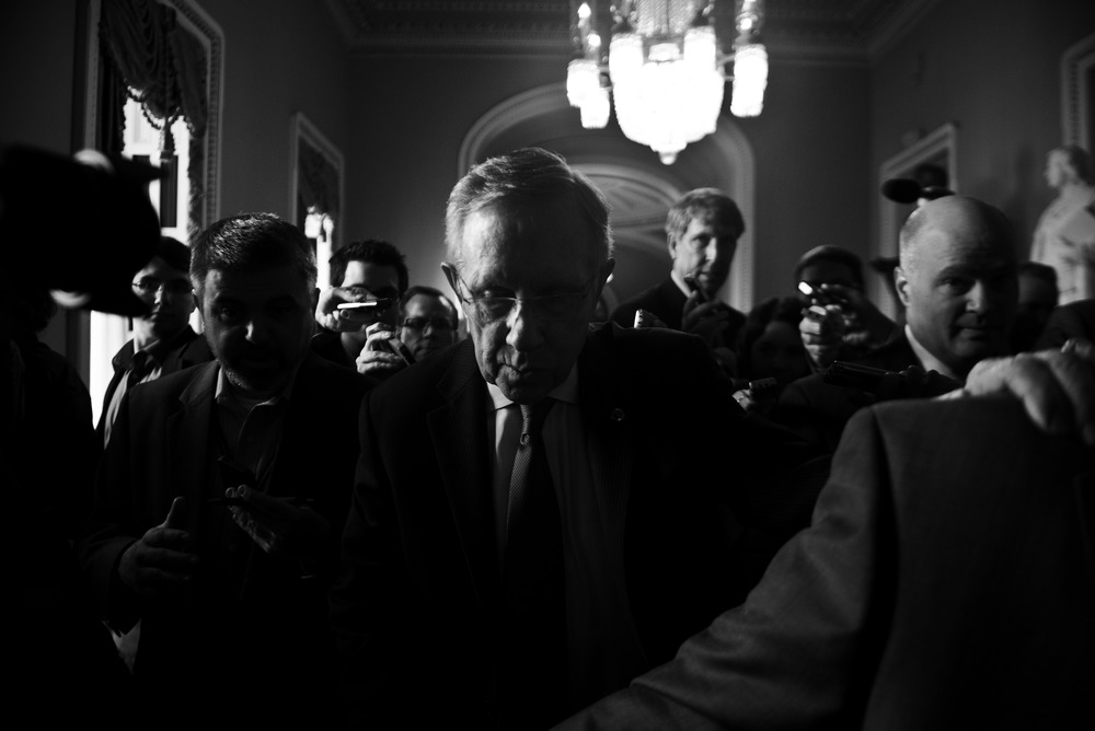 Senate Majority Leader Harry Reid of Nevada walks off the Senate floor en route to the office of Senate Minority Leader Mitch McConnell of Kentucky for a meeting at the Capitol. Republicans pushed to strip money from the new health care law which led to the government shutdown on Oct. 1, 2013.
