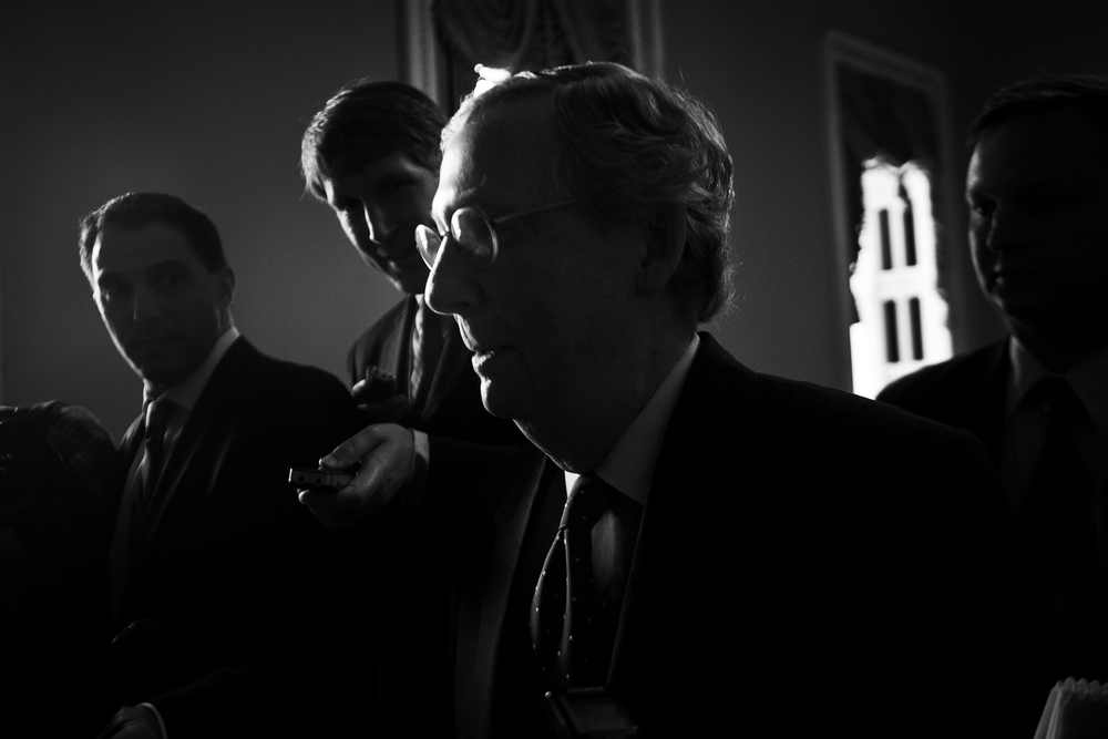 Senator Mitch McConnell of Kentucky, the Republican minority leader, negotiates a senate deal with Senator Harry Reid of Nevada, the majority leader, a day before the budget ceiling deadline and stressed that the budget cuts extracted in the 2011 fiscal showdown were not reversed, as some Democrats had wanted.