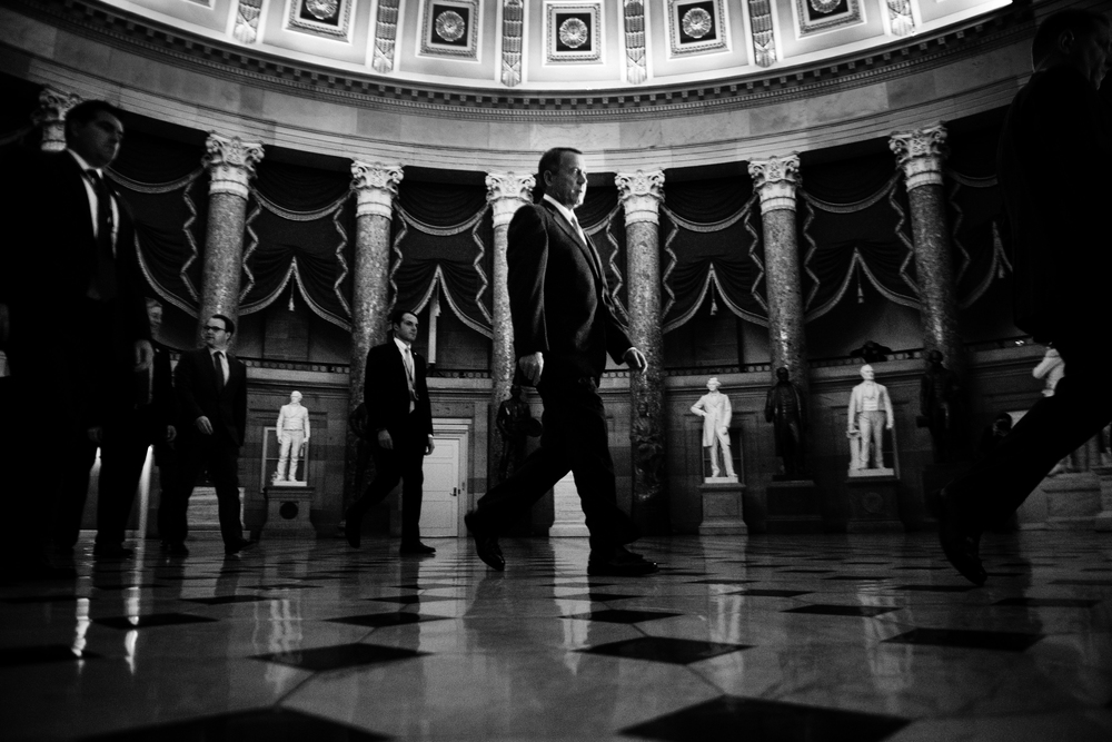 Speaker of the House John A. Boehner walks to the House floor to vote on the Senate bill. The bill passed in the House which later reopened the government and extend the debt ceiling.