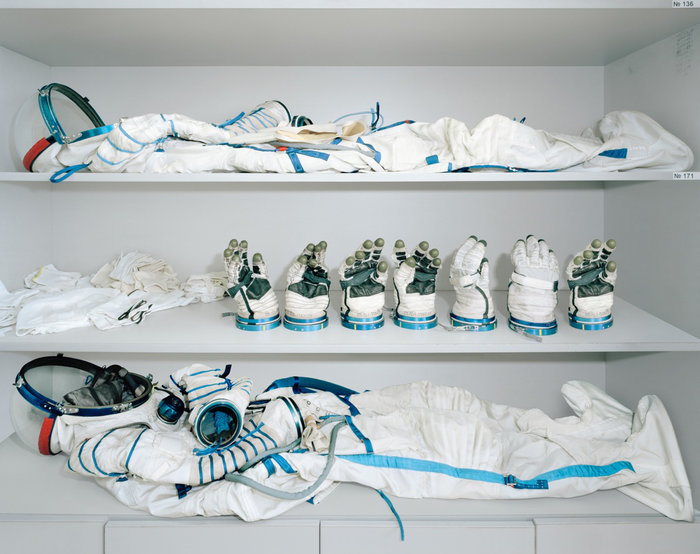 A Sokol suit with several different sized gloves, in storage atYuri Gagarin Cosmonaut Training Centre.