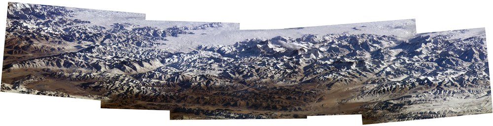 A mosaic photo of Mount Everest and the surrounding Himalayas