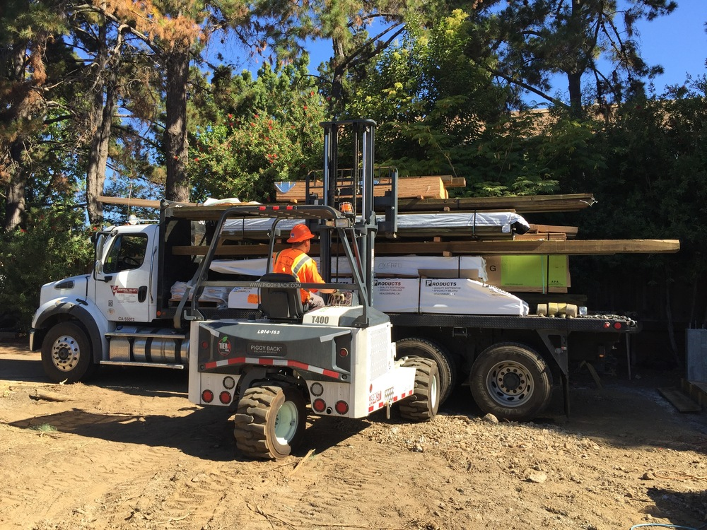 "That whole load isn't ours – just a portion of it. Pretty sweet ""piggy back"" forkllift uploads our lumber."