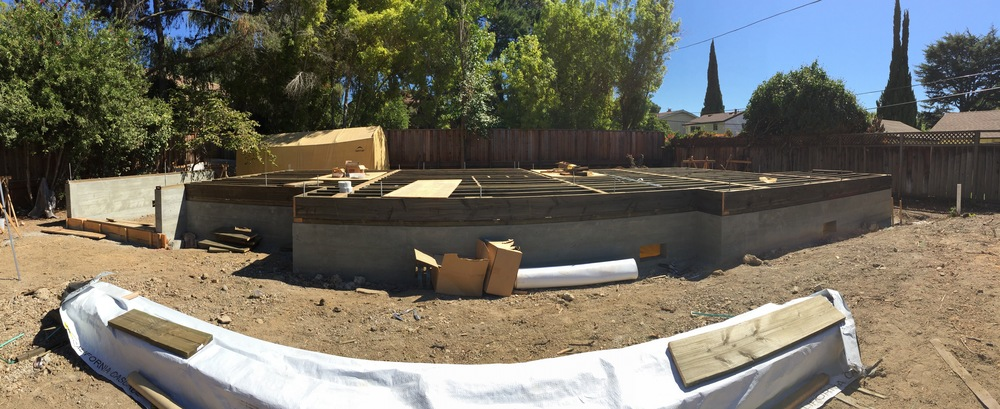 The house isn't curved, just a fish-eye effect from shooting in pano. The garage to the far left, entry nook just to the right of the garage, and the rest of the house.
