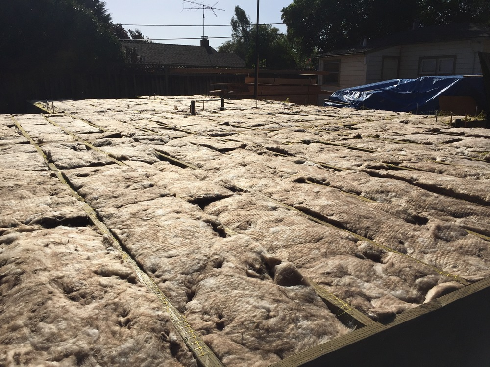At quick glance, it may look like buns baking in an oven, but it's really just the floor insulation sitting comfortably between floor joists in the sun.