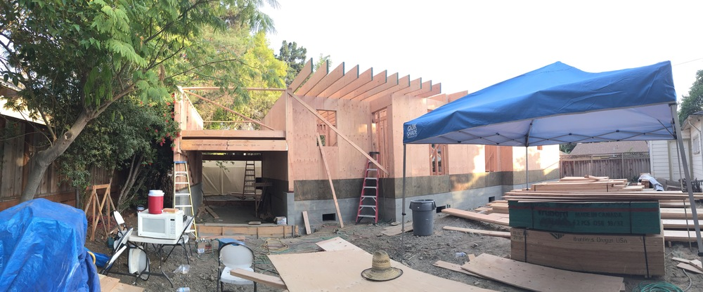 Roof rafters make their way down the house from right to left – heading towards the garage.
