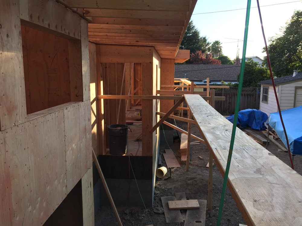 Exterior walls, topped with roof rafters, capped off with rim joists.