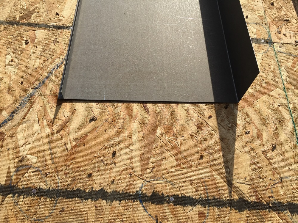 """This is the profile of the metal fascia that will cap the rim joist around the roof. The small crimp on the left is what will be the drip, while the 4"""" extension on the right, it what will slide directly on top of the plywood sheathing."""