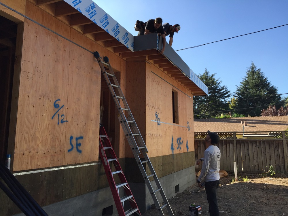 Here are the guys installing the metal fascia over the waterproofed rim joist fascia.