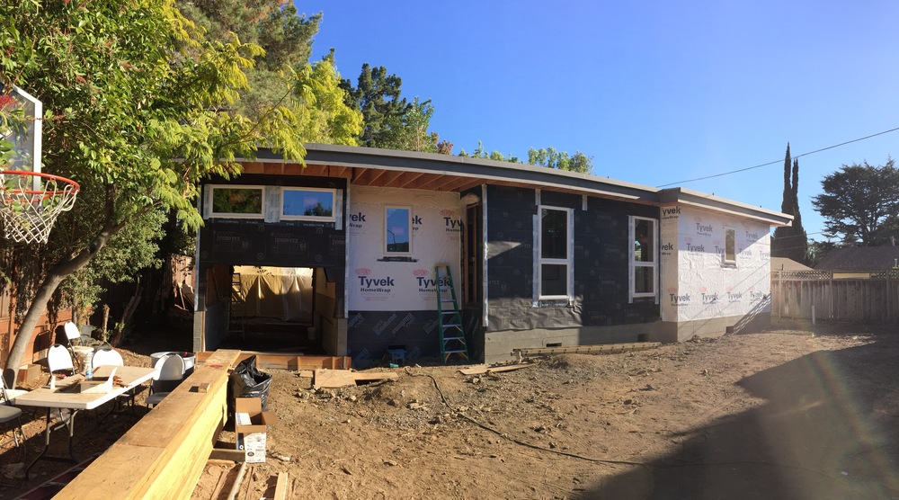 Here we are today. The roofing is done, the siding prep is ready for stucco and wood, windows are in, and we eagerly watch each day as construction continues!