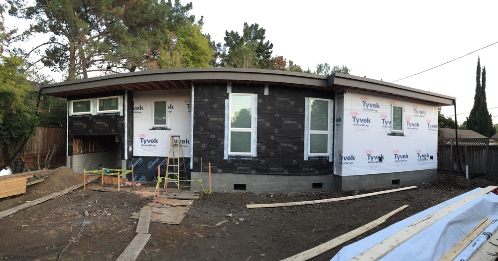 We're all roofed and papered in. Notice the two different kinds of building paper. White Tyvek for the cedar siding, and the black JumboTex for stucco.