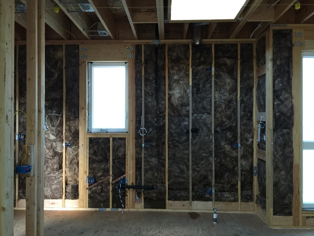 This is what it looks like with the insulation in the walls. It's fun to watch the guys install it. They have machete-like knives and cut to fit. It makes a huge difference not just in temperature, but also in sound insolation now that we have some soft surfaces.