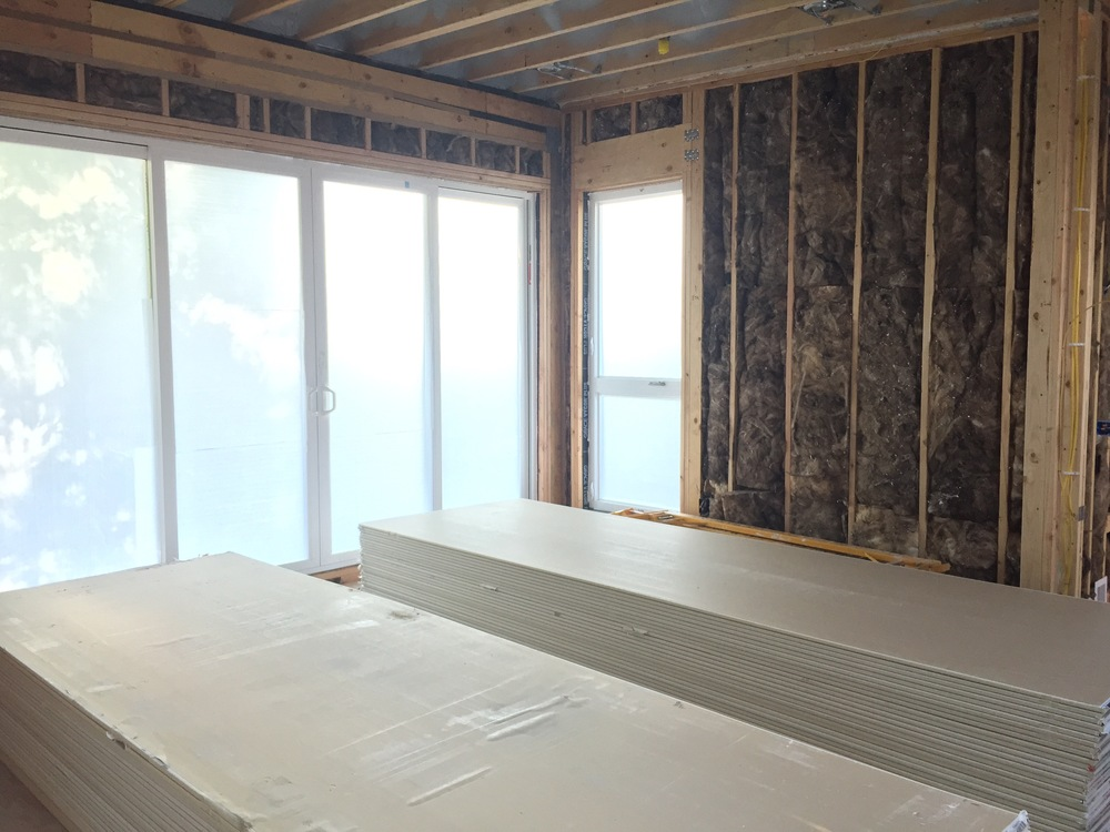 Drywall is already here to acclimate, and we'll start hiding away the skeleton of the house to produce a backdrop for our interior walls.