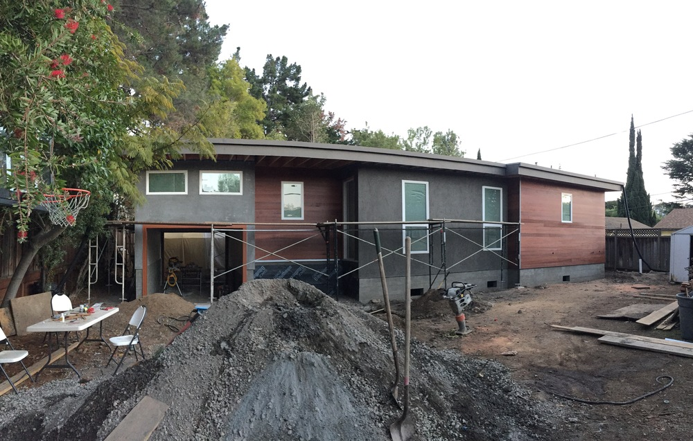 Here's an exterior shot that shows the wood siding already stained, and a relatively fresh brown coat of stucco. If you look closely, you can see the garage was done earlier, hence the lighter color from the stucco beginning to cure.