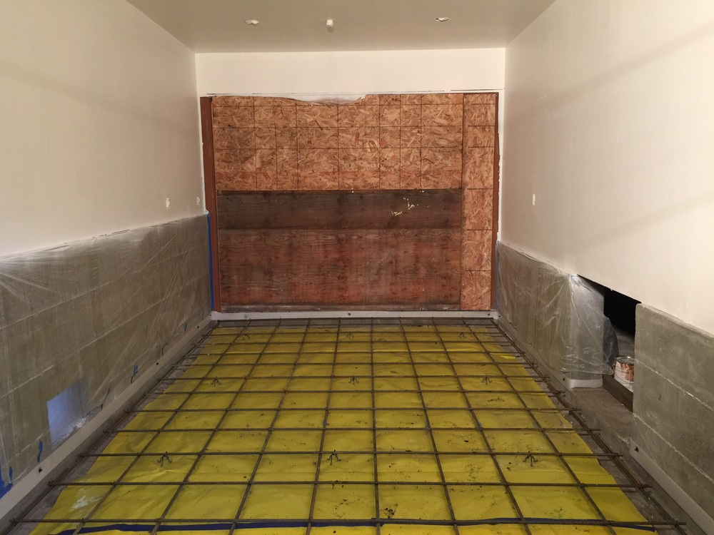 The garage floor. Also needs rebar and a vapor retarder underneath. That's the crawl space door to the right. As opposed to a more typical garage slab, we didn't slope this one. There will be absolutely no water spraying in here as it will serve as our new office space.