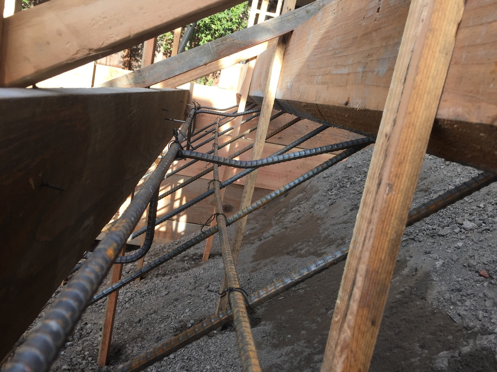 """A closer look at the reinforcing bar (""""re-bar"""") that will help the concrete to hold together and cause less cracks."""