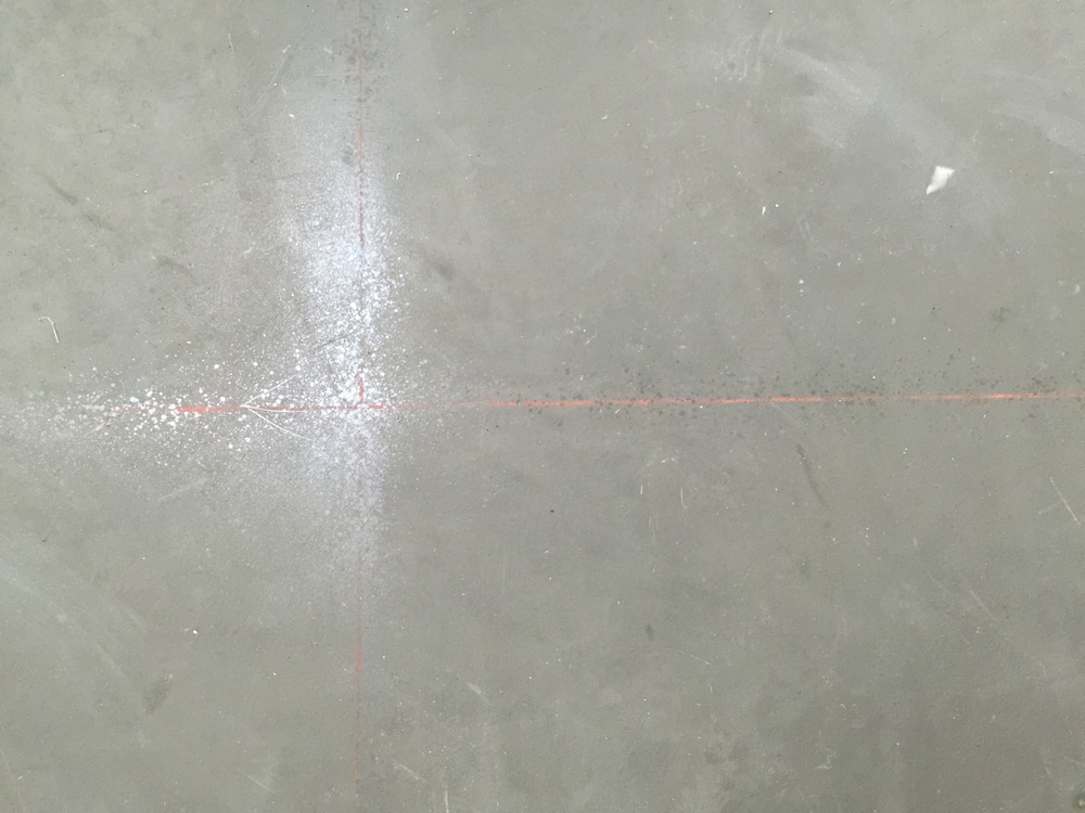 Chalk lines are snapped where the saw cuts will be added for control joints.