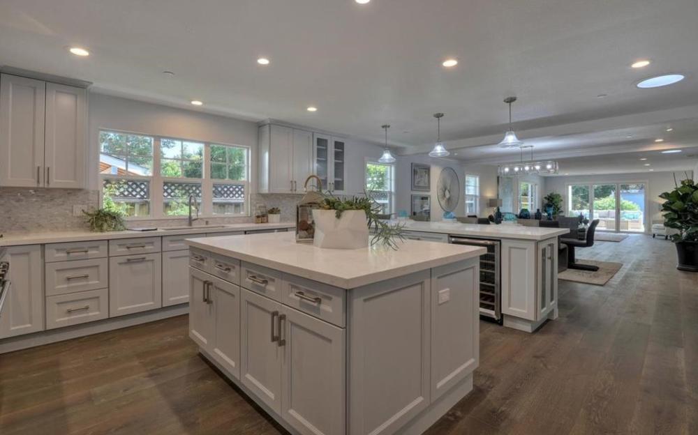 Kitchen, dining, living beyond.