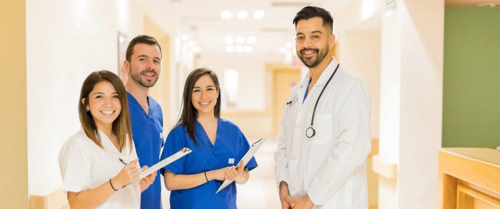 bigstock-Doctor-And-Interns-Standing-In-160992770.jpg