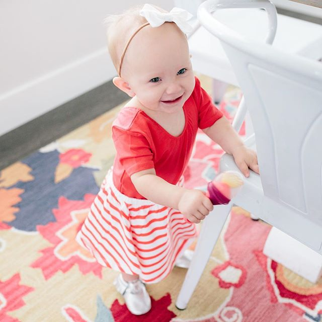 Monday's biggest fan❤️ girlfriend is so close to being mobile, It's so fun watching her grow up! Shes always moving and taking snacks with her. She's obsessed with these @booninc silicone teething feeders they sent us (much cleaner than any mesh kind!) you can get them at @target #boonpulp #boontoddlersnack || cutest skirt & leotard from @juneandjanuary & @freshlypicked moccs