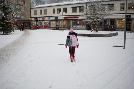 A girl walks home after school