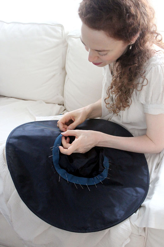Stiching interior ribbon to a silk hat