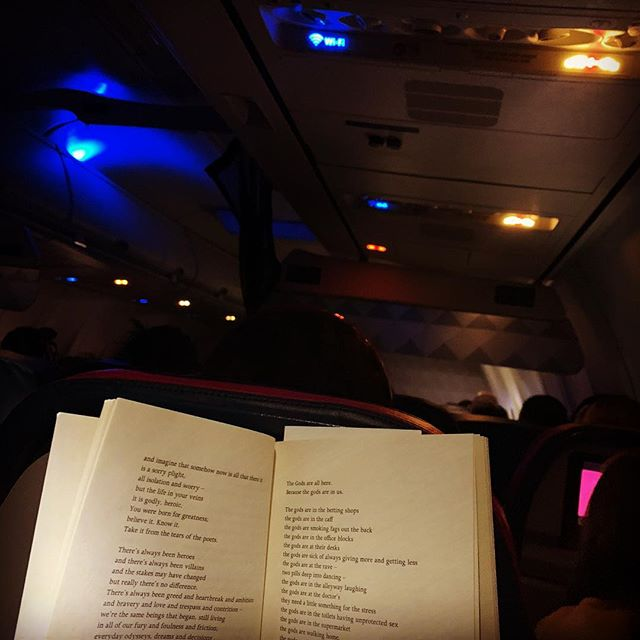 Brand New Ancients by Kate Tempest. The airplane's engines churn. Whispering as I read poetry aloud by spotlight in the dark cabin. Transported through air and word. #KateTempest #BrandNewAncients #poetry #churning #must @KateTempest