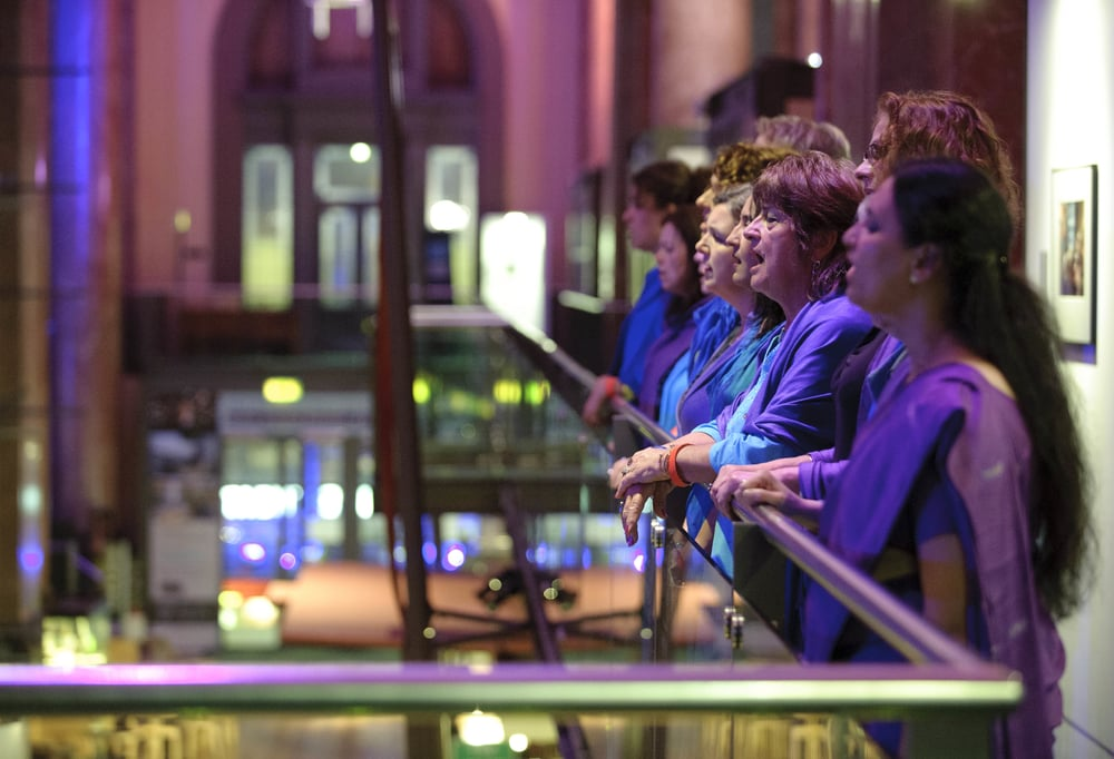 Sacred Sounds Women's Choir performing 'Lullaby' with Jason Singh at Royal Exchange Theatre. Photo: Joel Chester-Fildes