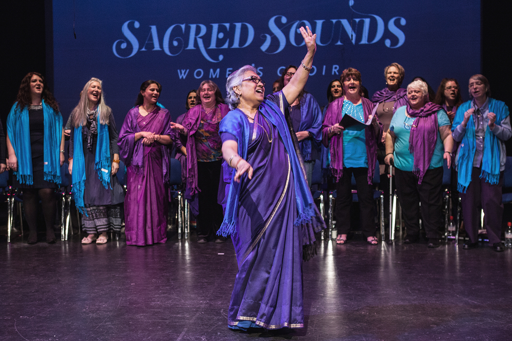 A choir member taking the lead during the Sacred Sounds Women's Choir 2015 showcase event at Z-arts Photo: Michela De Rossi