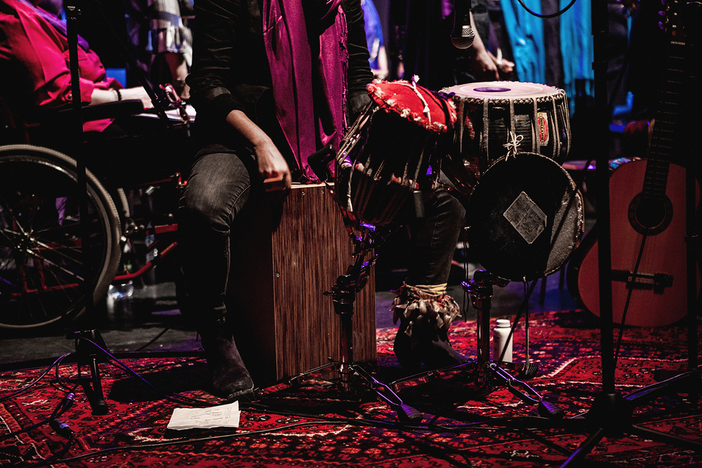 Renu Hossain providing percussion alongside the Sacred Sounds Women's Choir Photo: Michela De Rossi