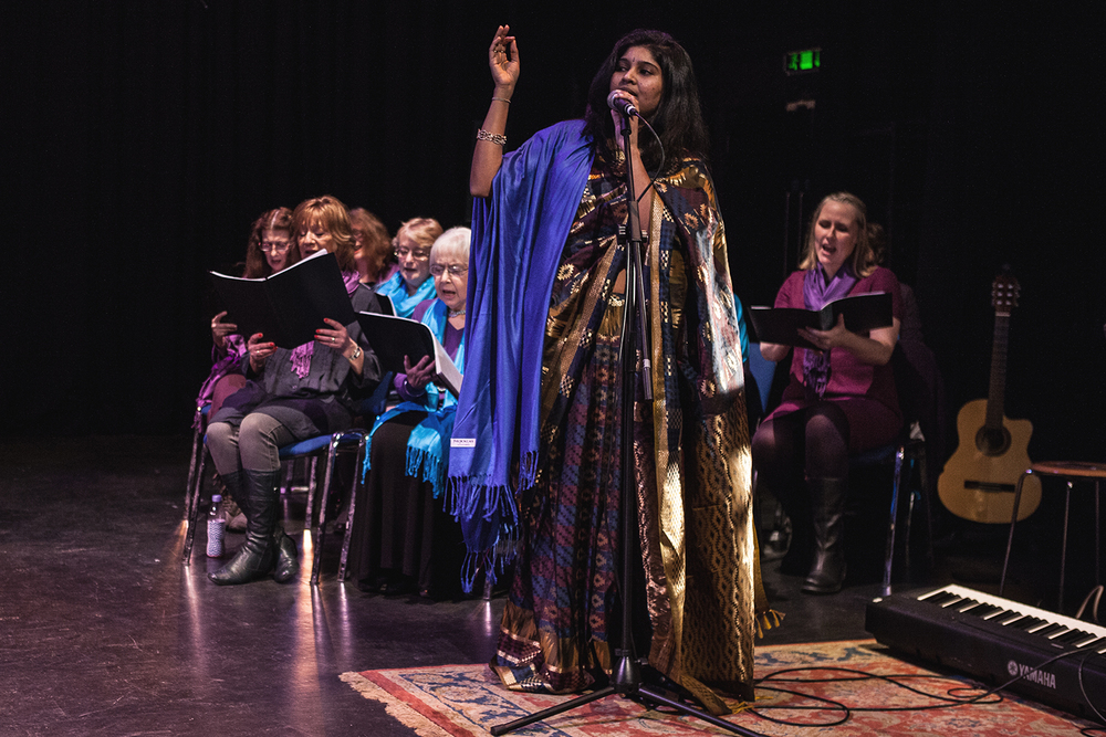 Madhu Tanjorkar performing 'Bolo Ram' with the Sacred Sounds Women's Choir Photo: Michela De Rossi