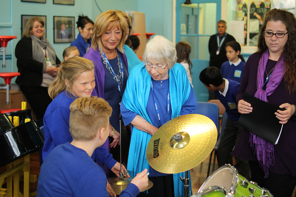 Pupils at Gorton Mount Primary Academy sharing their skills with the Sacred Sounds Women's Choir as part of an event celebrating World Music Day Photo: Mark Thomas for Manchester International Festival