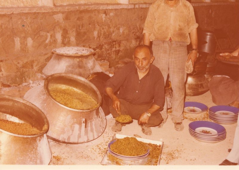 This was an Afghan  kitchen in the 1970s with a family's cook preparing Palau for a party, the  quintessential rice dish