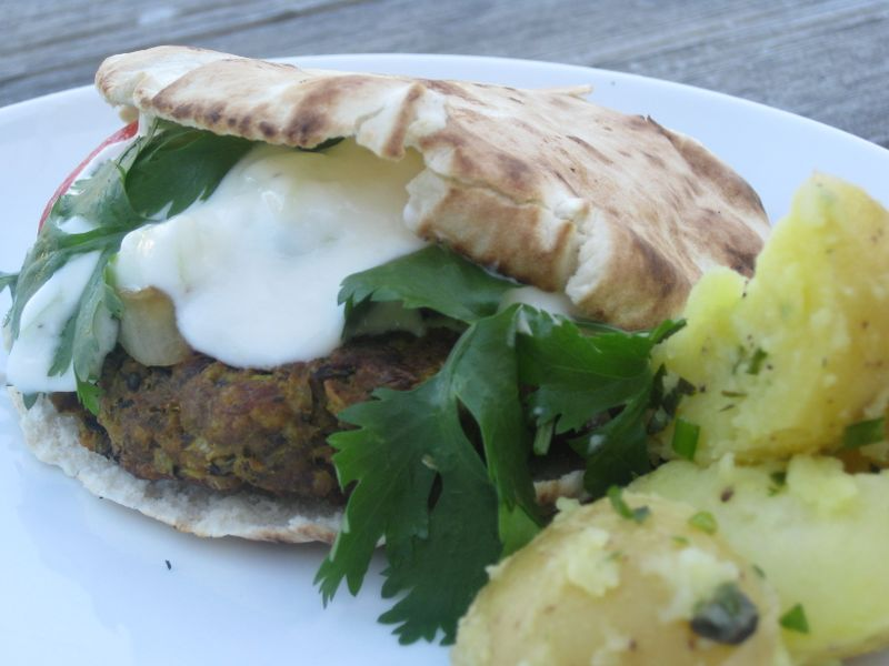 A cross-cultural burger:  An Afghan-spiced beef and bulgur kebab served on pita with yogurt
