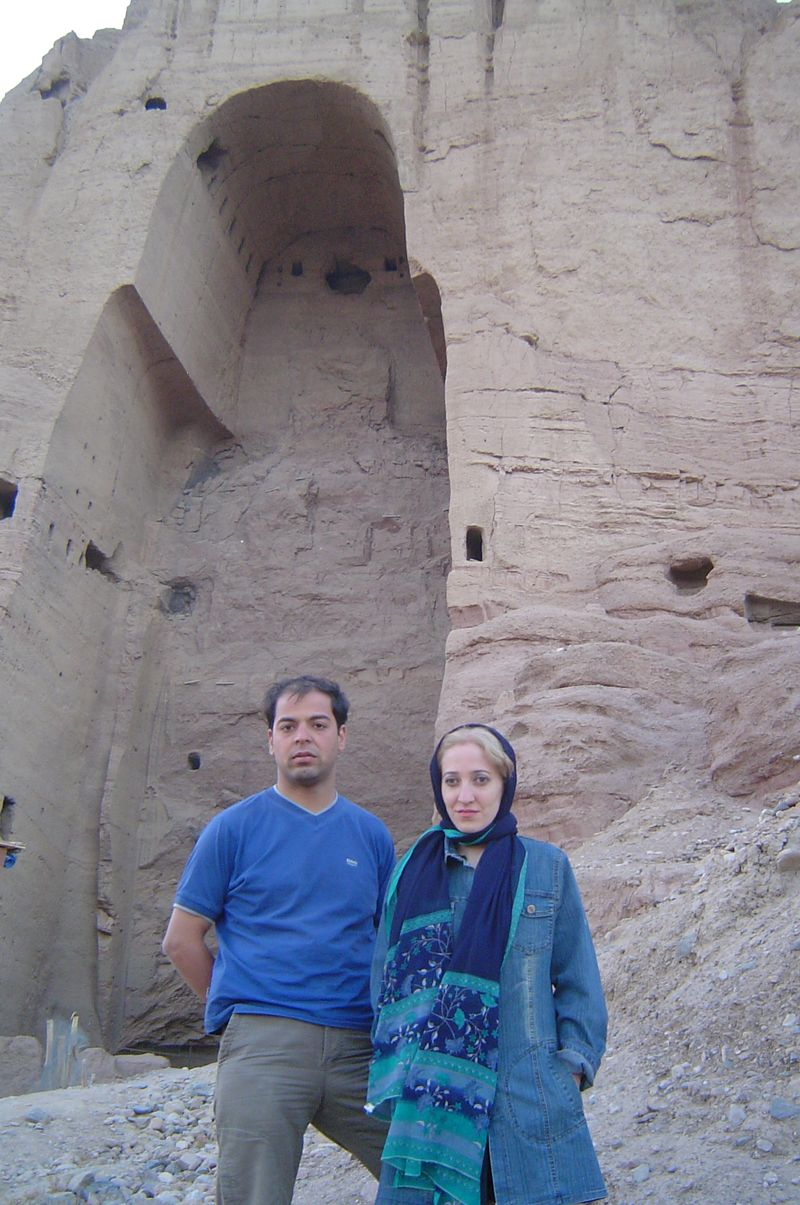 Fariba and her husband with sad faces infront of the destroyed statue in Bamiyan