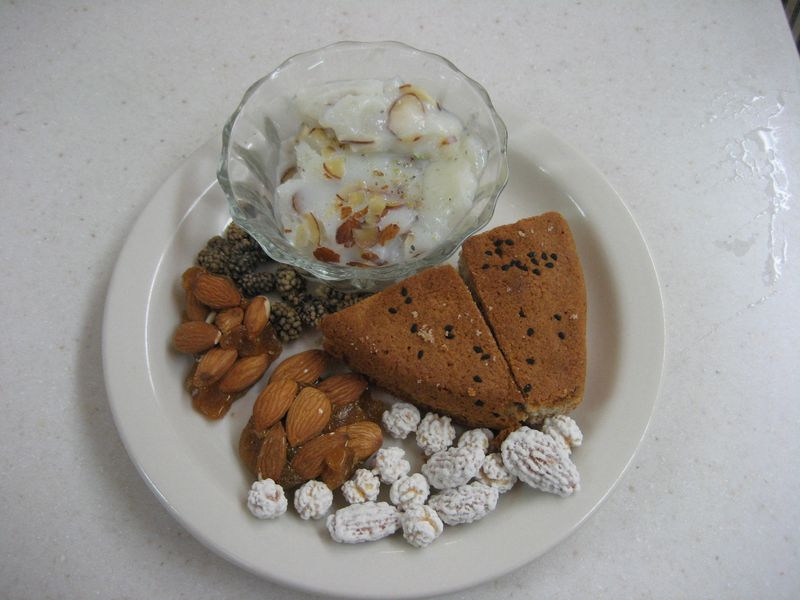 Firnee, noqul, khasta e shereen, and walnuts with dried mulberrie