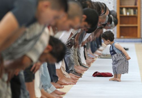 Muslims in Strasbourg, France praying during Ramaza