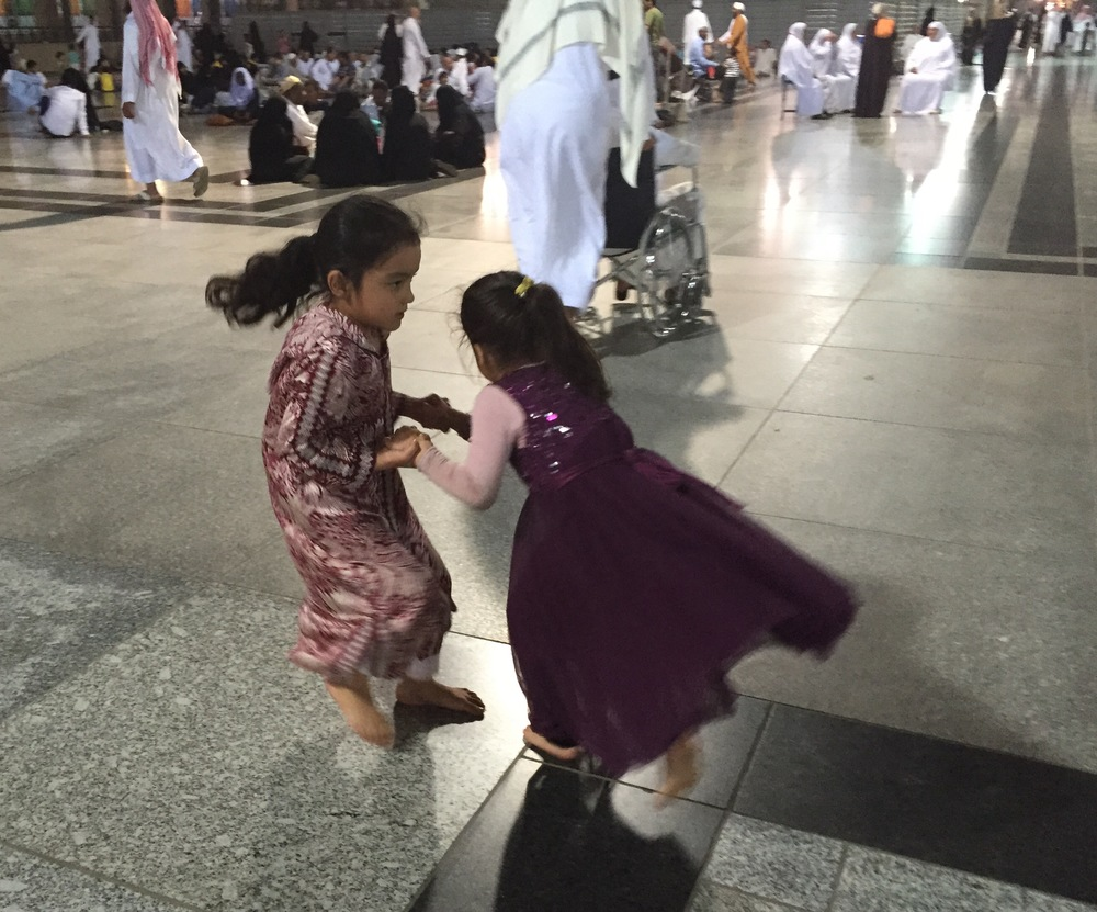 Holding hands and spinning is universal game for girls