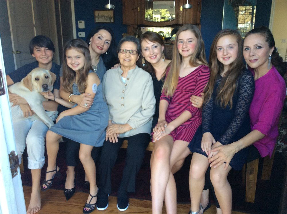 My mother with her daughters and some of her grandchildren.