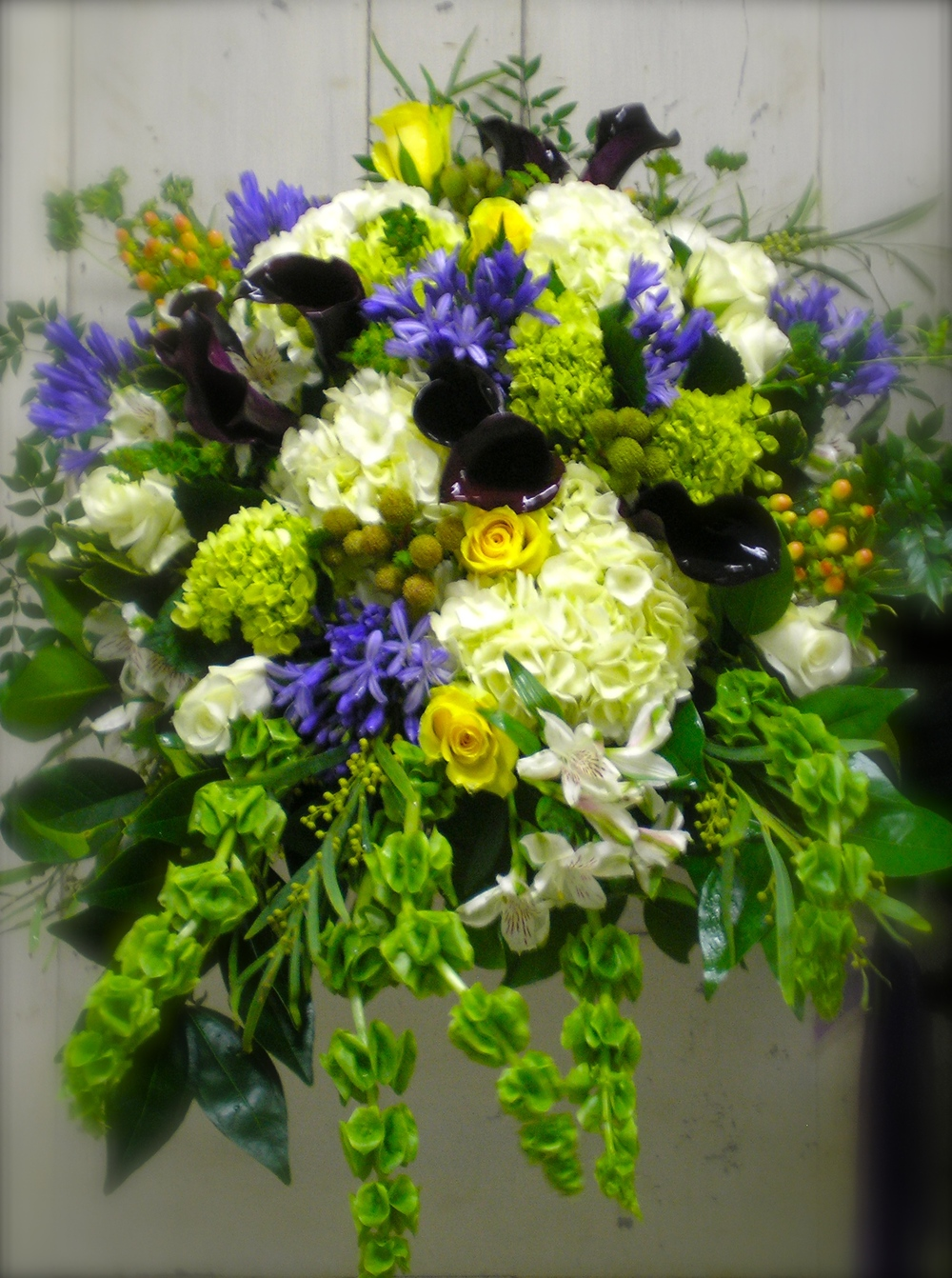 Casket Spray in Yellow, Blue & White