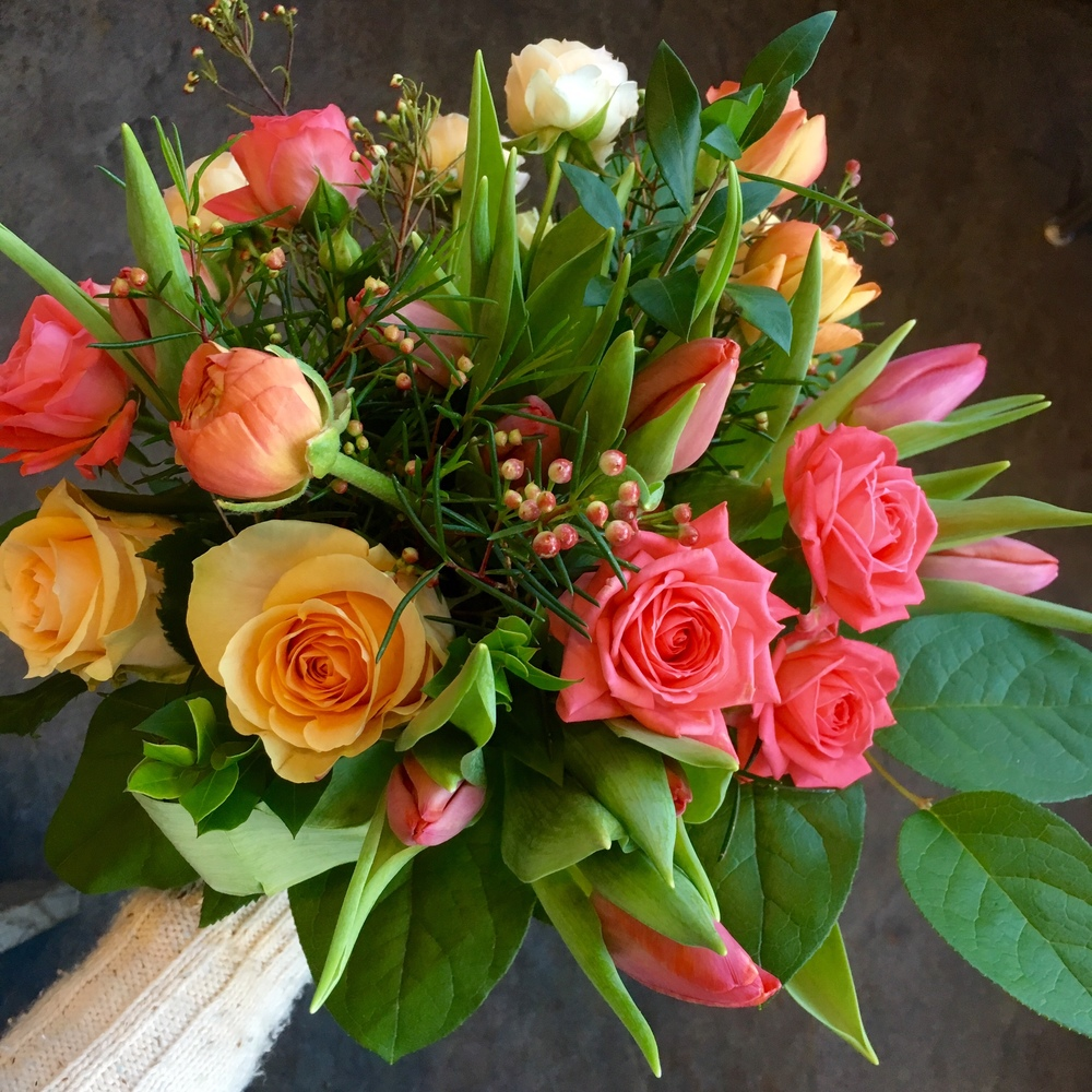 Coral and peach tulips, ranunculus & roses