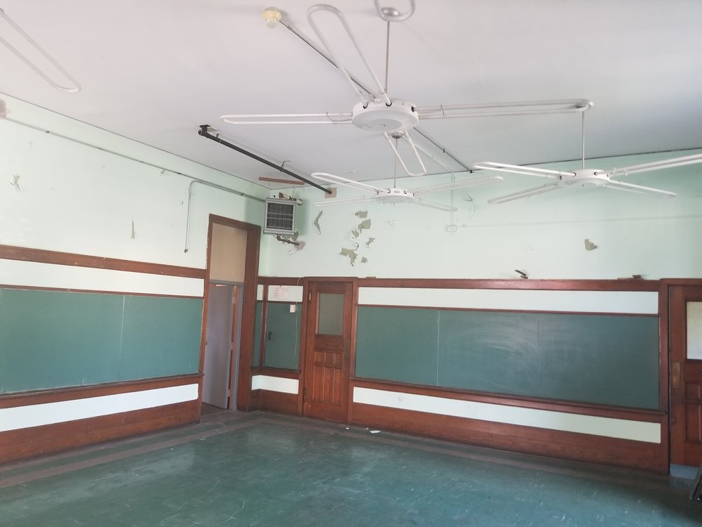 One of the classrooms with old chalkboards.