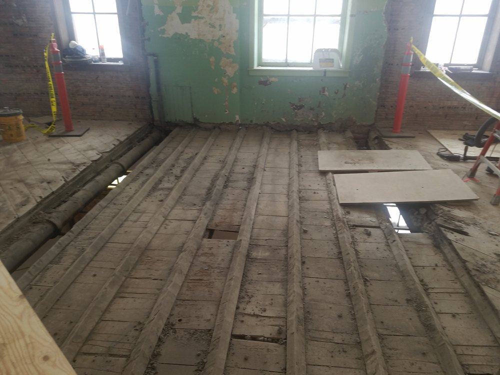 Rotten floor joists are being replaced.