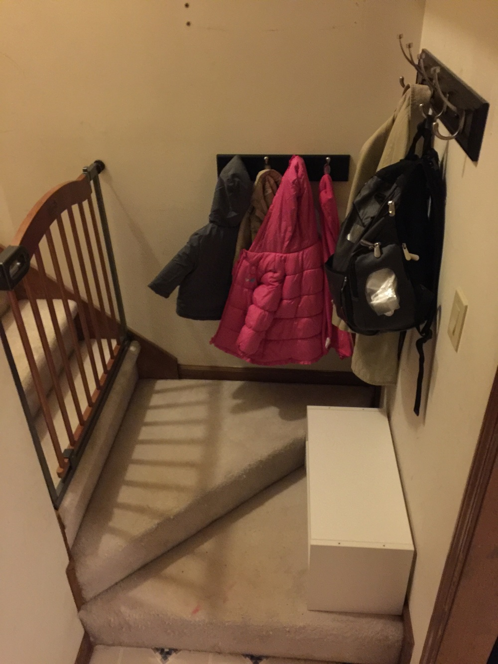 "Gate, coat hooks, floor shelf. ""Mud room."""